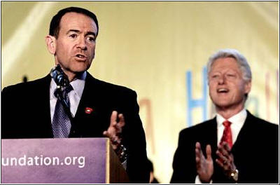 Huckabee (left) and Clinton have something in common--they've both lost weight and are urging others to do the same. Spencer Platt / Getty Images