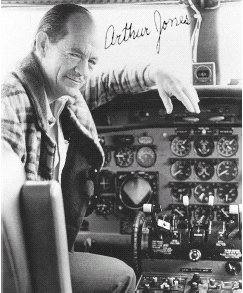 Arthur A. Jones sitting on a plane